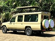 Hire safari car Entebbe Kampala Uganda - safari mini van with driver, land caruiser 4x4 4wd